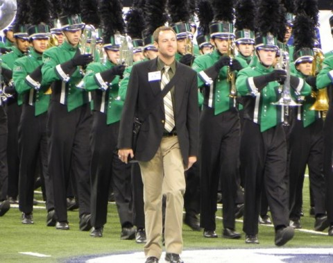 Green Hope Band Director leading band onto the field at XXX Stadium