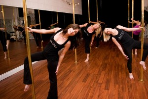 Aradia Fitness offers dance-based classes like these incorporating poles installed in the studio. Photo from their website