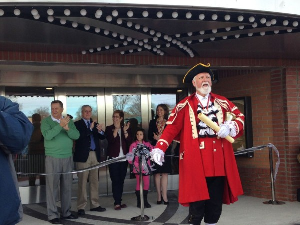 Cary' Town Crier John Webster from Sister City, Markum, Canada, welcomes the crowd to the grand opening of The Cary
