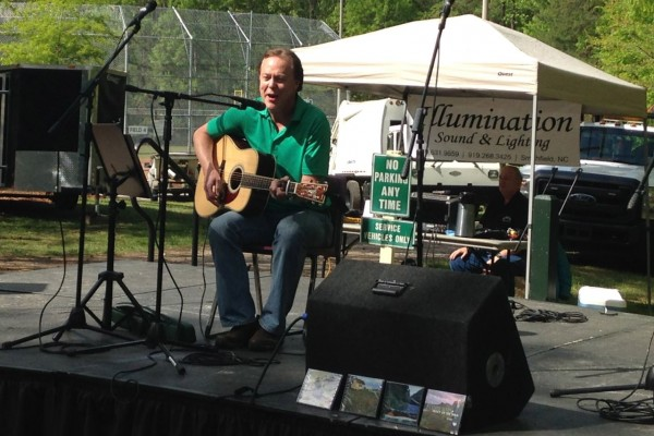 Bill Leslie plays a solo gig on one of the stages at Spring Daze