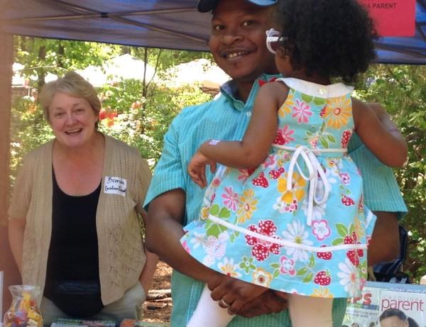 Brenda Larsen, publisher of Carolina Parent at the Children's Village they sponsor in the playground