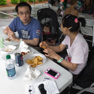 festival goers sample foods before voting for their favorites
