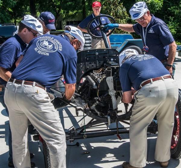 A team assembles a Model T