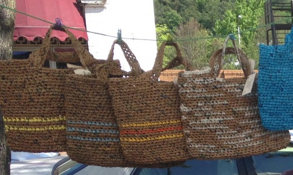 Tote bags on display at the farmer's market