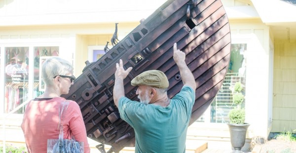 "Charles Pilkey speaks to juror Renee PXXX as he installs his piece ""Ark"""