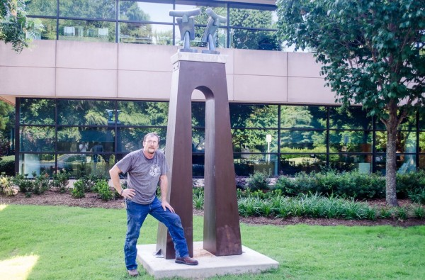 Artist Shawn Morin with his work installed on Town Hall campus