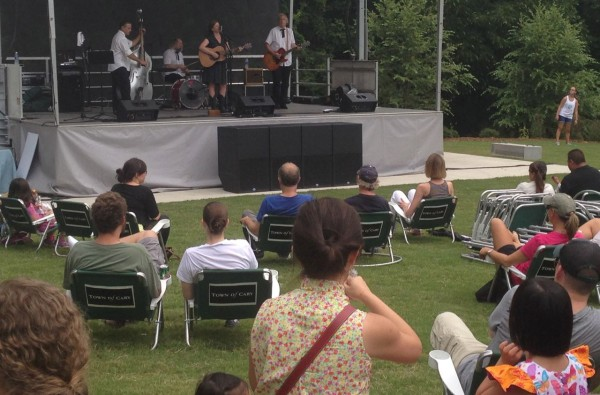 the Town provided chairs for people to sit and enjoy musical acts on the stage in the performance green