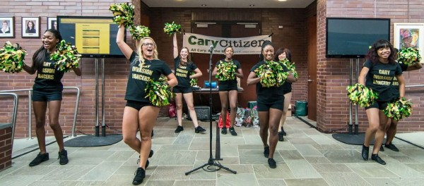 Cary Invasion cheerleaders on stage