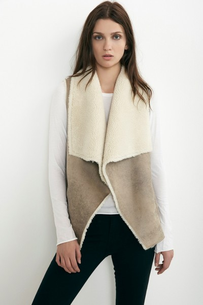 A sherpa vest by Velvet can be found at Peachy Keen