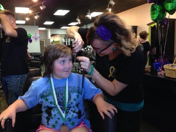 Amanda Kimball giving a haircut during Twisted Scizzors Cut-a-thon