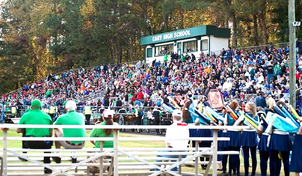 Crowds of supporters fill the stands each year at Cary High School to support marching bands.
