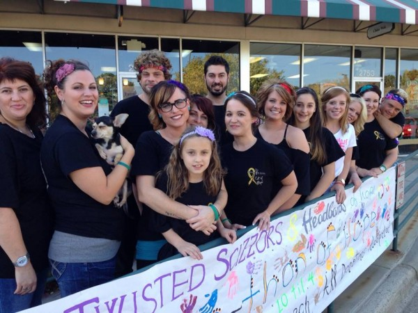 The Staff at Twisted Scizzors wearing headbands in honor of their charity