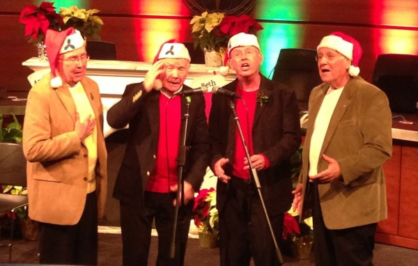 The Never Home 4 performed several variations on holiday tunes in barber shop quartet style to open the evening