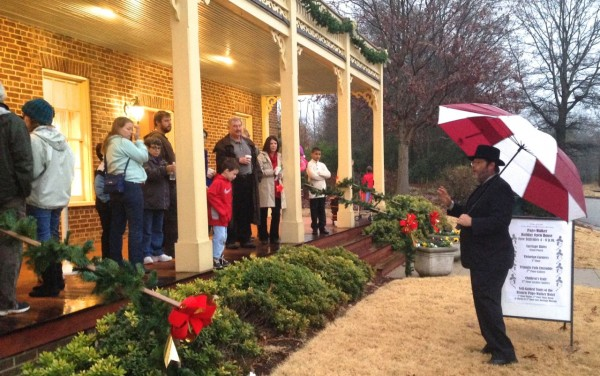 Brent Miller, president of the Friends of Page-Walker, talks to visitors about the building's history
