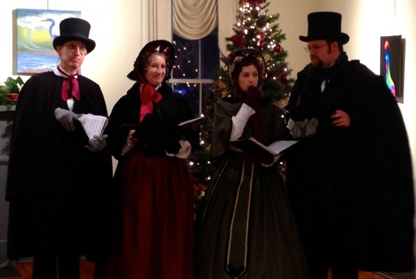 Carolers on the first floor gallery of Page-Walker
