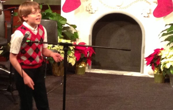 Nine Year old, Evan Sackeroff wowed the crowd with his rendition  of Rocking Around the Christmas Tree
