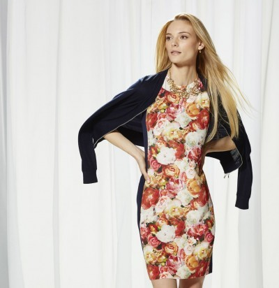Magaschoni floral dress paired with a moto jacket