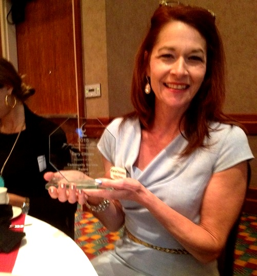 Lindsey Chester shows off our new Community Service Award.