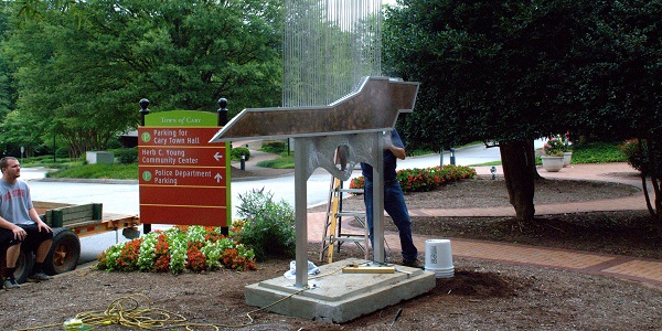 Cary artist Phil Hathcock puts the finishing touches on his sculpture, Windstone.