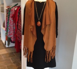 At Swagger we found an adorable faux suede fringed vest light enough to wear now