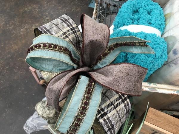 This soft-toned bow mixes burlap, aqua green and a bit of menswear .