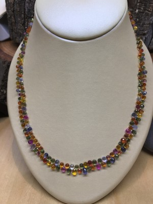 She'll feel extra special if she received this multi-colored sapphire stone necklace from Stonehaven Jewelry in Downtown Cary.