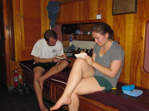 Freund and a fellow student making notes on board the Corwith Cramer before it departed.