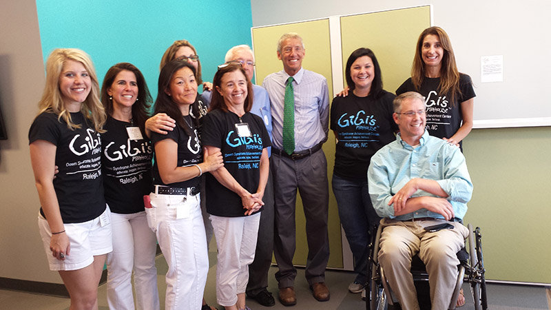 Cary Mayor Harold Weinbrecht with Holly Springs Mayor Richard Spears and the board of directors for Gigi's Playhouse.