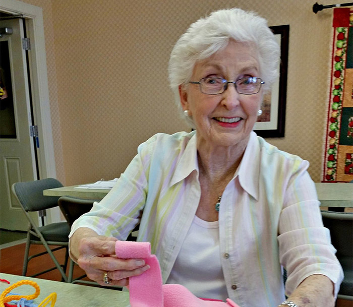 Waltonwood Cary Parkway resident Lu Mazzu making toys for cats at the Wake SPCA.
