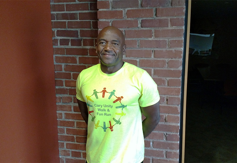 Jimi Clemons with the Cary Unity Walk's shirt