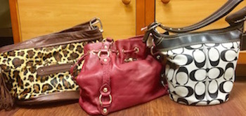 hese designer bags are all available at Annie's Attic in Ashworth Village. This consignment shop stocks a great assortment at reasonable prices: $95-119.