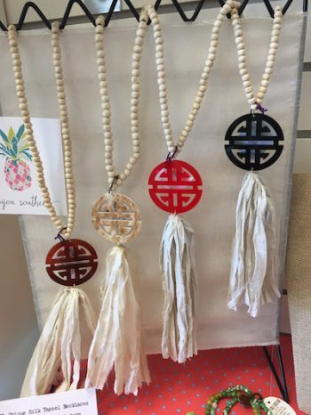 Made right here in Holly Springs, Bijoux Southern necklaces take the monogram and mix it with a fabric tassel fro a statement necklace right on trend. Laura Lee Gifts, $39
