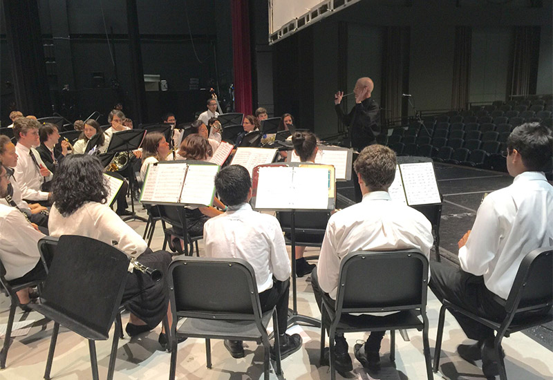 Cary Academy's band practicing, with both students, alumni and faculty