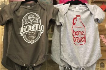 With the popularity of craft brews, these onsies are a cute gift for new parents from Made in Stone Creek Village $18
