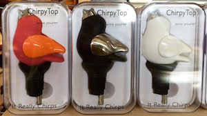 These cute bottle toppers actually sing while you pour wine. Chirpy Tops at Whisk in Waverly Place